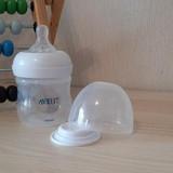 Philips Avent Natural pudelīte ar knupīti + aizsargvāciņš pudelītei pieniņa glabāšanai.
